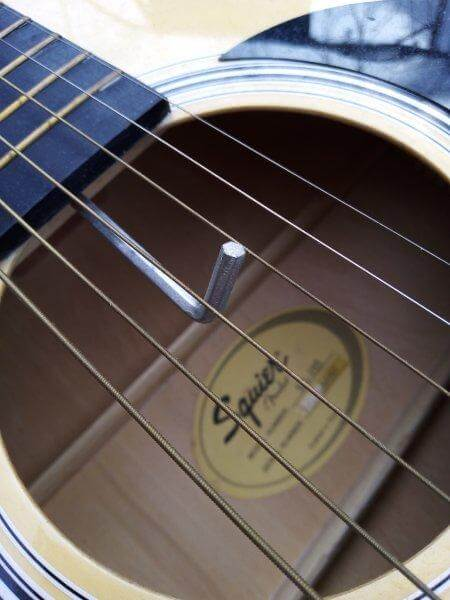 Placing the hex key to adjust the truss rod